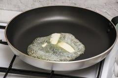 Pan met boter Stock Afbeelding