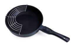 Pan met ceramisch non-stick deklaag en rooster-tussenvoegsel stock foto's