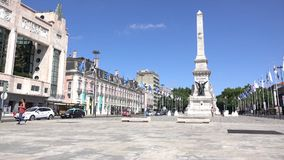 Pan of monument in Restauradores Square stock footage