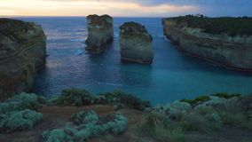Pan move of Island Archway lookout at sunset in Twelve Apostles on the Great Ocean Road in Australia stock video footage