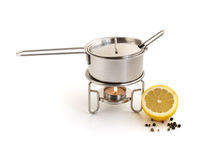 Pan for mulled wine preparation and lemon. Pan for mulled wine preparation Royalty Free Stock Photography