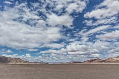 Pan of the Namibia desert with mountains and cloudy sky. Africa stock photos