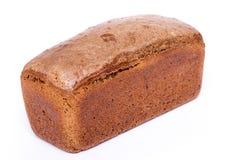 Pan negro bajo la forma de ladrillo Foto de archivo libre de regalías