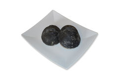 Pan negro del carbón vegetal en plato Foto de archivo