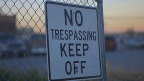 Pan of No Trespassing Keep Off Sign. Pan shot of No Trespassing Keep Off Sign on a fence near the border stock video footage