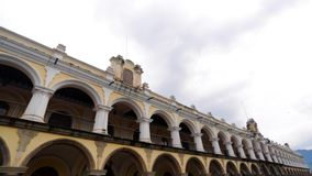 Pan of old building in a town square in Antigua, Guatemala Royalty Free Stock Image
