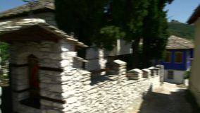 Pan from old wall to blue turks house in Theologos, Thassos Greece stock footage
