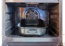 Pan in an open oven Royalty Free Stock Photography