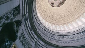 The dome inside of US Capitol in Washington DC. Pan over the dome inside of US Capitol stock video