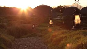 Pan over path with lanterns during sunset stock video footage