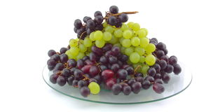 Pan of a pile of Grapes on glass table stock video footage