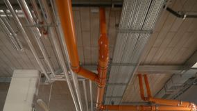 Pan of pipes in building