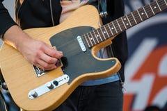 Pan playing electric guitar at concert. Pan playing electric guitar at live concert Stock Photos