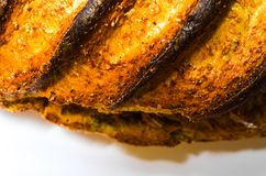 Pan quemado en el fondo blanco Imagen de archivo libre de regalías