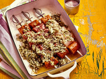 Pan of raw churrascos with skewers stock photography