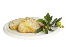 Pan rebanado con aceite de oliva Foto de archivo