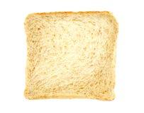 Pan rebanado en blanco Fotos de archivo