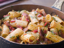 Pan of Rigatoni Pasta with Tomato and Pancetta Royalty Free Stock Photography