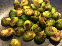Pan-roasted brussels sprouts Stock Image