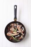Pan-roasted lamb chops and mushrooms Stock Images