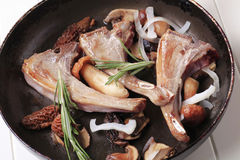 Pan-roasted lamb chops and mushrooms Stock Photos