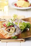 Pan-roasted trout and green salad Royalty Free Stock Photo