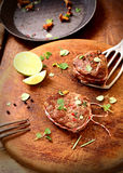 Pan roasting medallions of fillet steak stock image