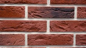 Pan rode decoratieve baksteen uw huis Metselwerkachtergrond Uniek tekeningsblok stock footage