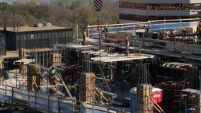 Pan rooftop construction timelapse stock video footage