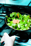 Pan salad. Woman cooking salad with carrots for a healty life Royalty Free Stock Photography