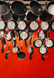 Pan For Sale. The pans suspended from the ceiling are for sales Stock Photo