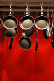 Pan for sale. The pans suspended from the ceiling are for sales Royalty Free Stock Photography