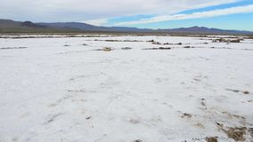 Pan Salt Valley In The Desert On The Place Of The Dried-Up Sea Or Lake. Panorama from the bottom up, white salt valley in the desert on the site of a dried lake stock video footage