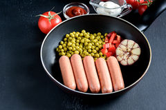 Pan with sausages and vegetables Tasty dinner Place for text Above Royalty Free Stock Image