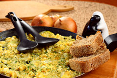 Pan with scrambled eggs Stock Photo