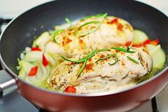 Pan seared chicken breasts cooking in frying pan Stock Photography