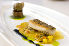 Pan seared, crispy skinned cod molecular cuisine Royalty Free Stock Photos