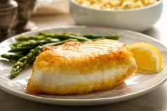 Pan Seared Halibut. Delicious pan seared halibut with asparagus and wild rice Royalty Free Stock Images