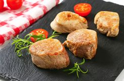 Pan-seared pork medallions Stock Image