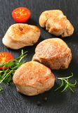 Pan-seared pork medallions Stock Photography