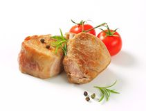 Pan-seared pork medallions Stock Images