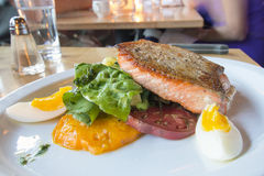 Pan Seared Salmon Filet with Vegetables and Eggs Stock Photo
