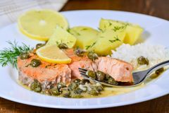 Pan seared salmon with lemon garlic caper butter sauce royalty free stock photo