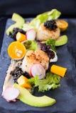 Pan seared scallops with salad, avocado, radish, mango and black Stock Photos