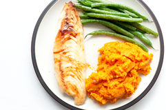 Pan seared tilapia fish fillets with sweet potato and green bean Royalty Free Stock Images