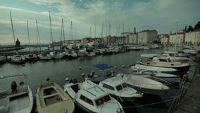 Pan shot of bouts in port. Marina ports with bouts and yachts on cloudy day stock video