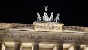 Pan shot of the Brandenburg Gate at night. Real time left to right close up shot of The Brandenburg Gate in Potsdam, Germany. It is a famous tourist place with stock video
