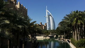 Pan shot of the Burj Al Arab Hotel in Dubai, United Arab Emirates stock video footage