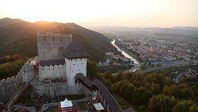 Pan shot from castle to the city and back stock footage