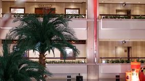 Pan shot of high rise hotel building inside big shopping mall stock video